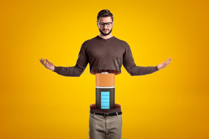 Front view of young hadsome man doing meditation gesture, his body cut at waist and upperbody lifted in air, with big stock photos