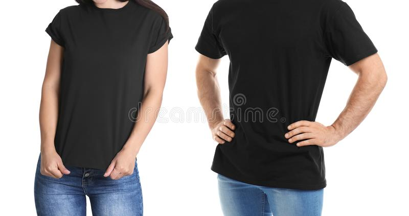 Front view of young woman and man in black t-shirts stock photo