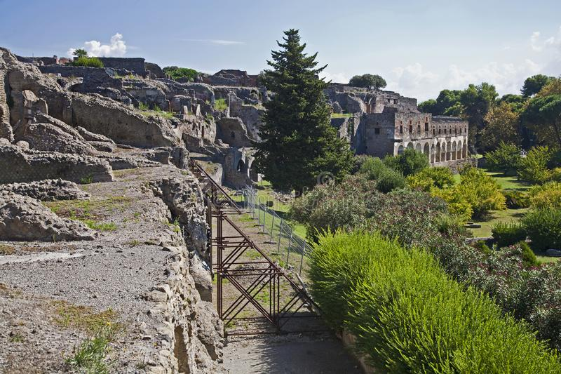 Front walls at Pompeii. Crumbling walls at the historic site of Pompeii in Italy royalty free stock image