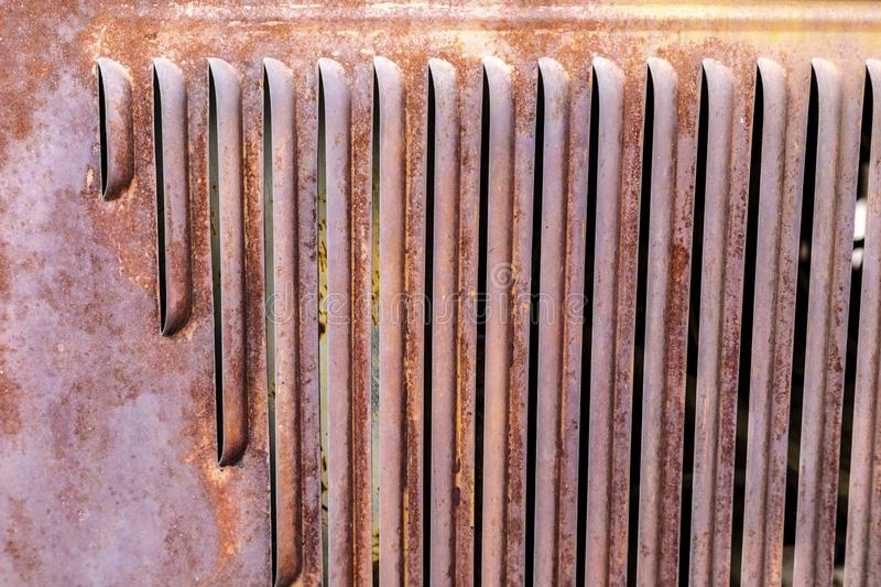 Front of weathered aged radiator. From an old truck in junkyard royalty free stock image