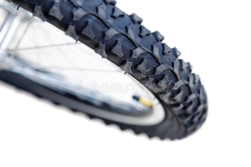 Front wheel of bicycle. Rubber bicycle tire close-up. Mountain bike. Wheel protector profile. stock images