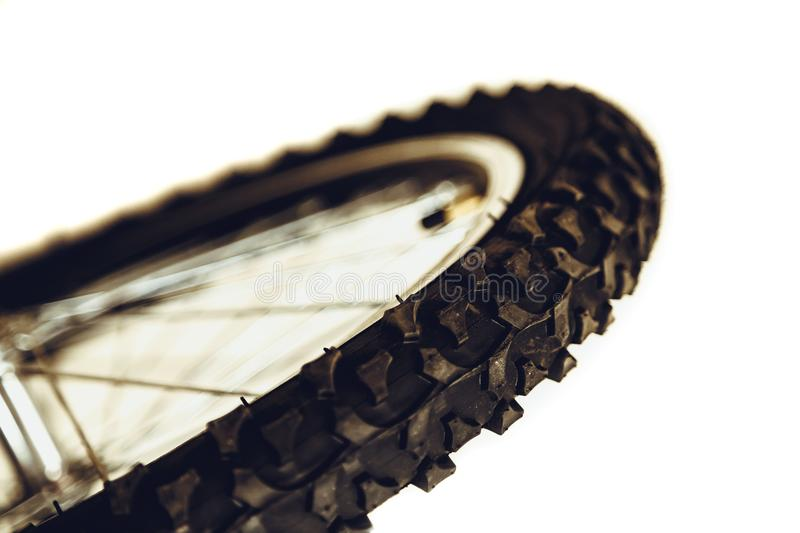 Front wheel of bicycle. Rubber bicycle tire close-up. Mountain bike. Wheel protector profile. Front wheel of bicycle. Rubber bicycle tire close-up. Mountain stock image