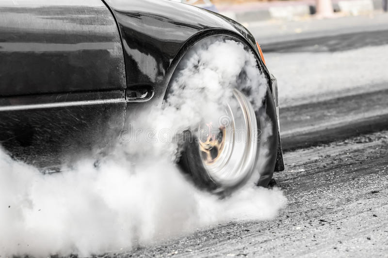 Front wheel drive drag racing car at start line. In track stock photography