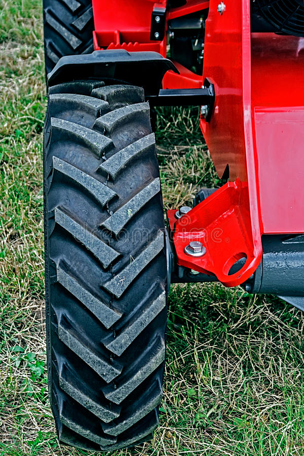 Front wheel of one tractor stock photo