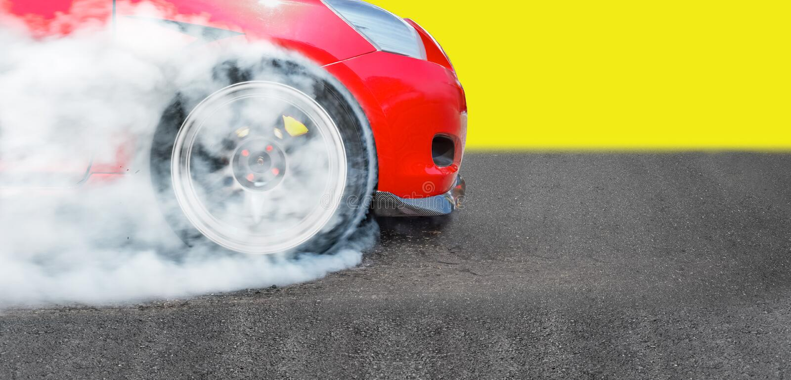 Race drift car burning tires on speed track. Front wheel Race drift car burning tires on speed track stock images