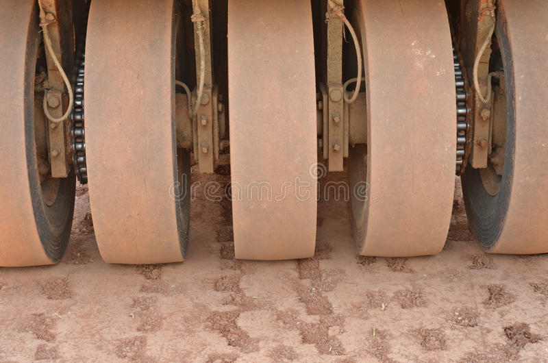 Front wheels of compactor. Front wheels of vibratory roller compactor royalty free stock photos