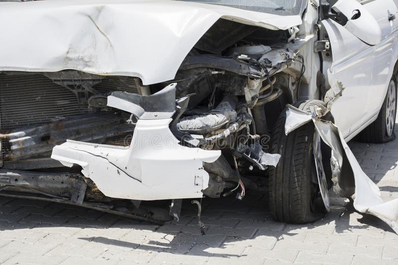 Front of white car get damaged by accident on the road stock images