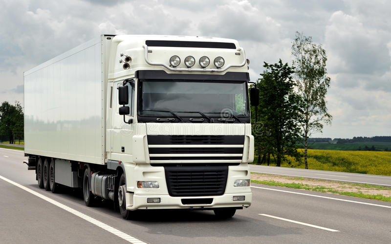 Front of white truck on the highway royalty free stock image