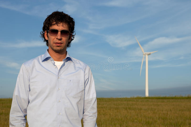 Front windmill. Man is standing in fron of a windmill royalty free stock photography