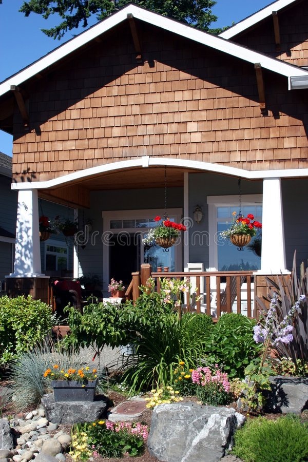 Front Yard. A beautiful garden at a craftsman style home stock image