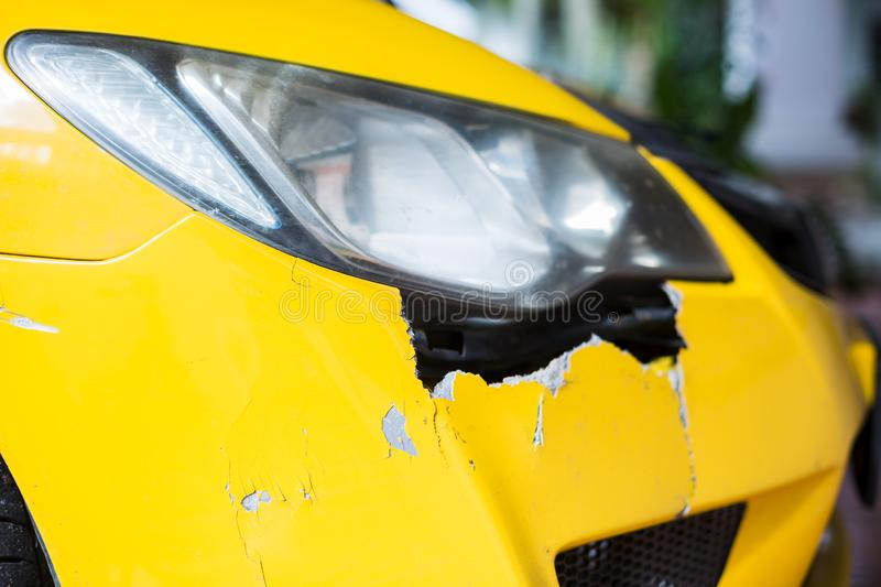Front of yellow car get damaged by accident on the road. Yellow car crash accident royalty free stock images