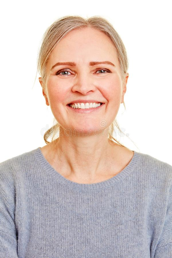 Frontal face of a smiling elderly woman royalty free stock photos