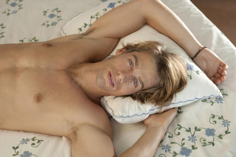 Download Frontal Portrait Of Man In Bed Royalty Free Stock Image - Image: 24687286