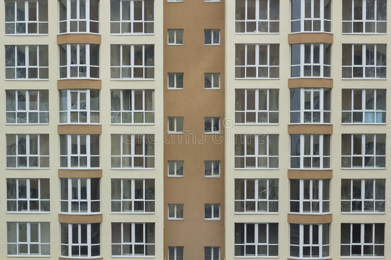 Frontal view of the facade of building with a lot of windows stock photos