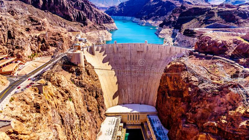 Frontal View of the Hoover Dam from the Mike O`Callaghan–Pat Tillman Memorial Bridge. Frontal view of the Hoover Dam, a concrete arch dam in the stock photos