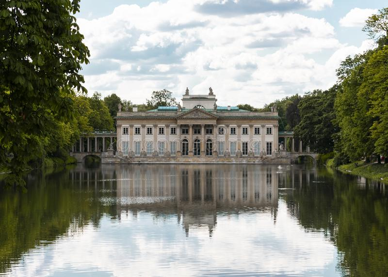 Frontal view of Lazienki Palace and lake in Lazienki Park, Warsaw royalty free stock photos