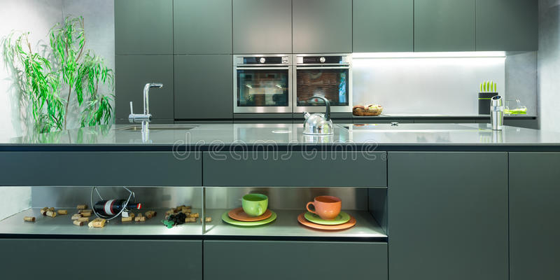 Frontal view of modern anthracite kitchen royalty free stock photos