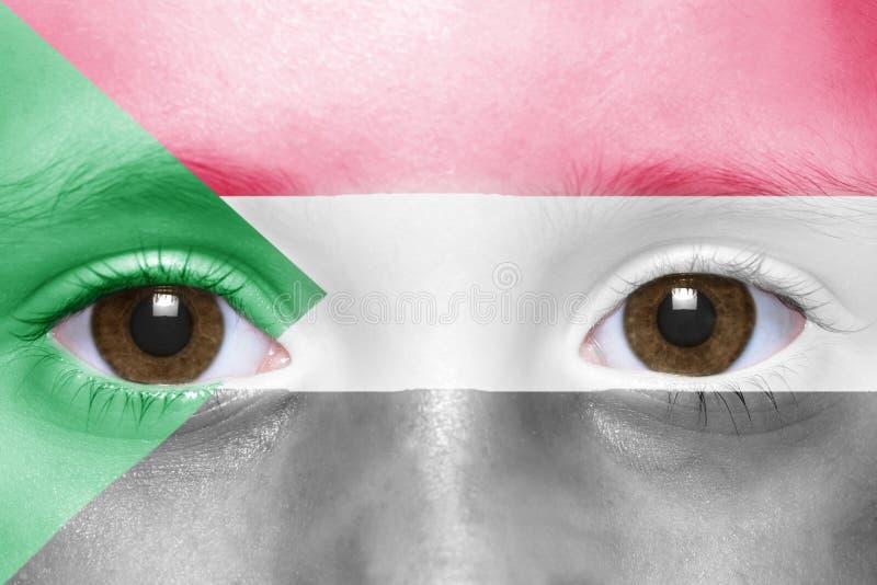 Fronte con la bandiera del sudanese immagine stock libera da diritti