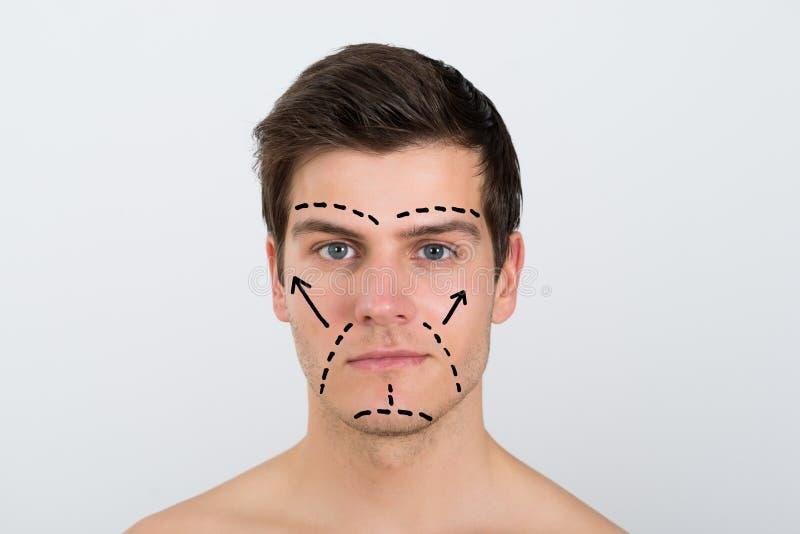 Fronte dell'uomo con le linee di perforazione fotografie stock