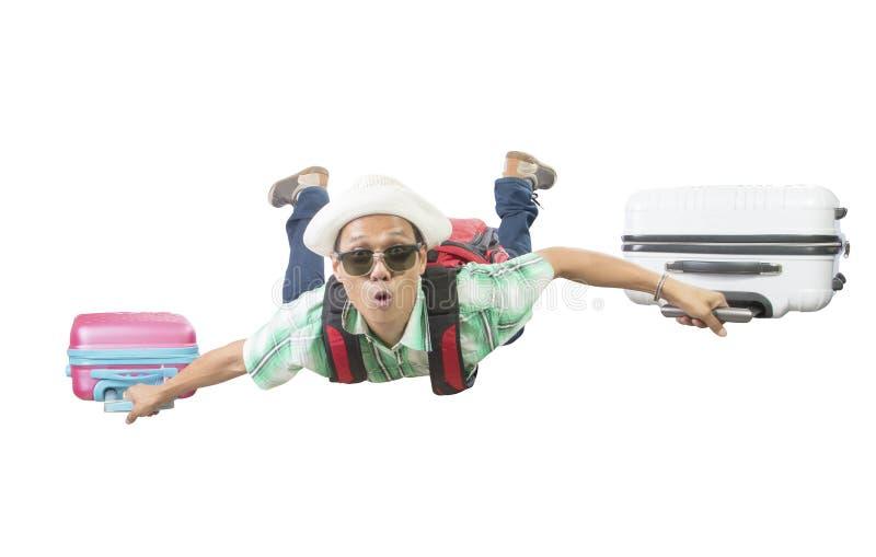 Fronte di felicità del volo di viaggio asiatico dell'uomo con due sedere dei bagagli immagini stock