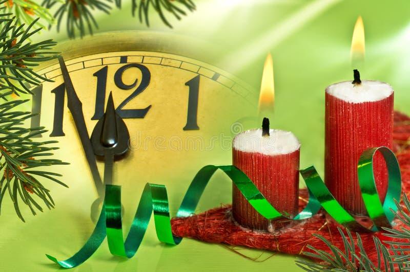 Fronte di orologio con le candele fotografia stock libera da diritti