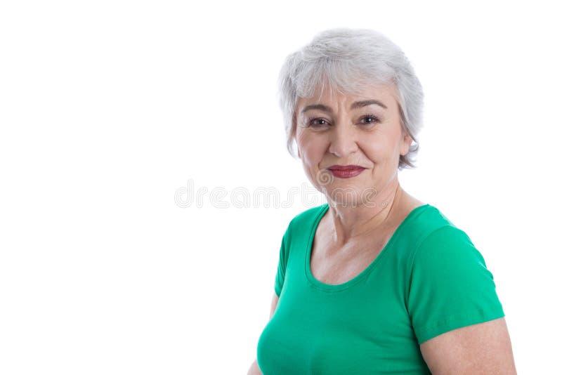 Fronte di una donna più anziana felice isolata sopra bianco. fotografia stock libera da diritti