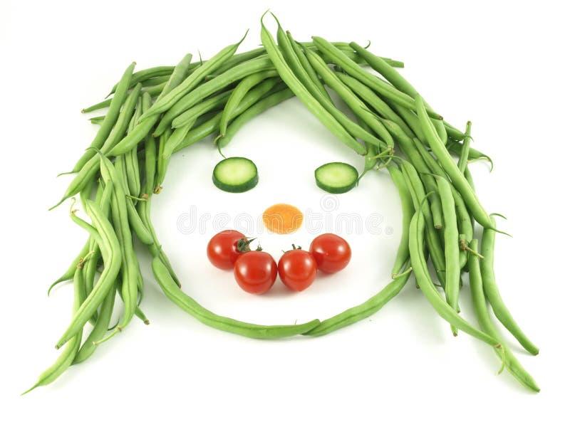 Fronte divertente delle verdure. fotografia stock