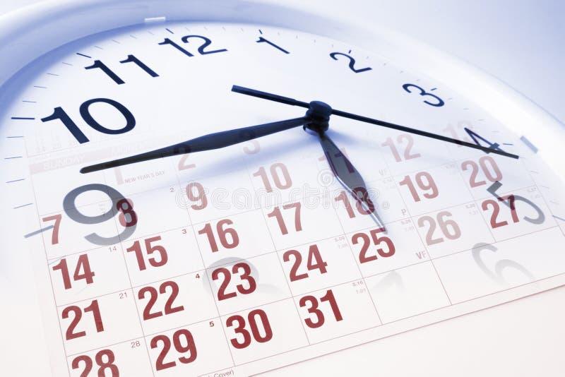 Fronte e calendario di orologio fotografie stock libere da diritti