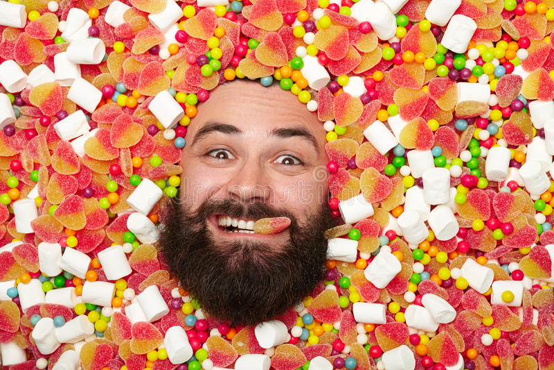 Fronte maschio in caramelle immagini stock