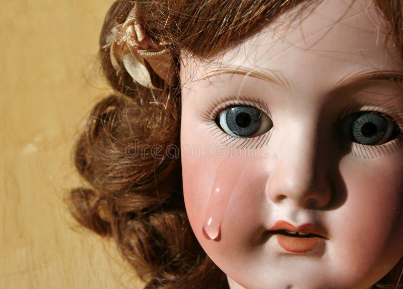 Fronte rotto della bambola fotografia stock