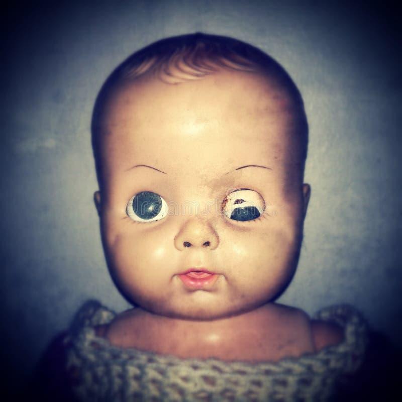 Fronte terrificante della bambola fotografia stock