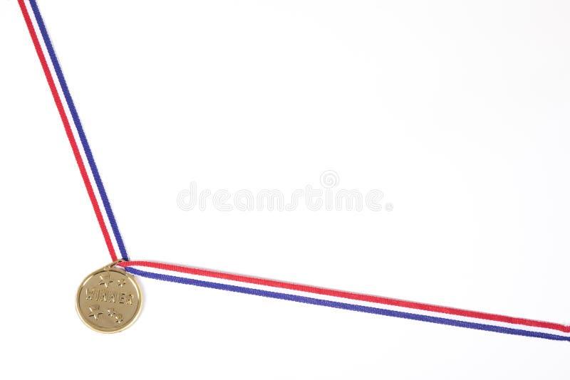 Frontera de la esquina con una medalla de oro en una cinta imagen de archivo