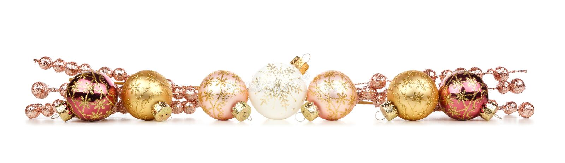 Frontera de la Navidad de las decoraciones del oro y del cobre aisladas en blanco imágenes de archivo libres de regalías
