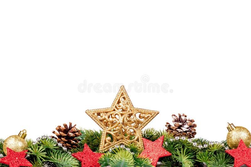 Frontera de la Navidad - ramas de árbol con las bolas, el caramelo y la decoración de oro foto de archivo libre de regalías