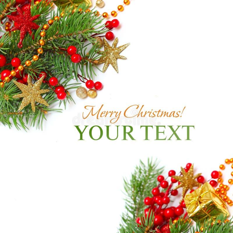 Frontera de la Navidad - ramificación, estrellas y decoración verdes fotografía de archivo