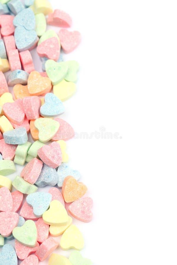 Frontera de los corazones del caramelo foto de archivo