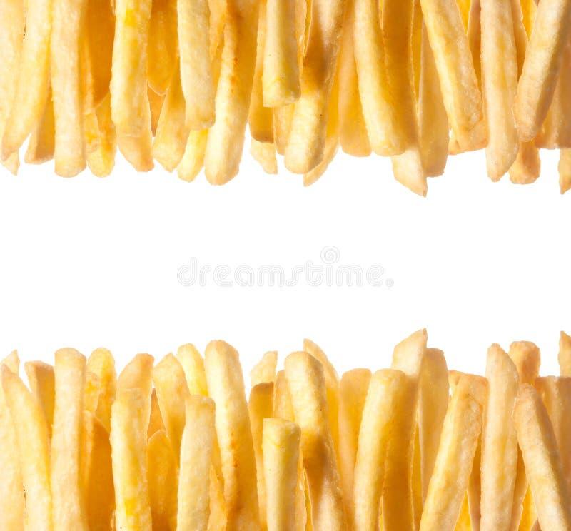 Frontera de patatas fritas de oro quebradizas fotos de archivo libres de regalías