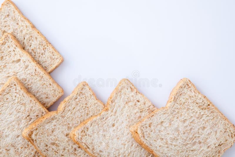 Frontera del pan del trigo integral de la rebanada foto de archivo