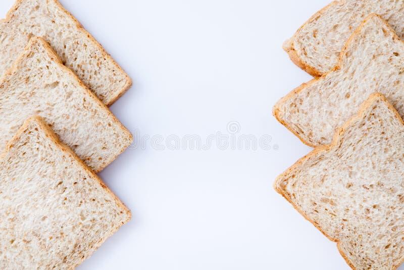 Frontera del pan del trigo integral de la rebanada imágenes de archivo libres de regalías
