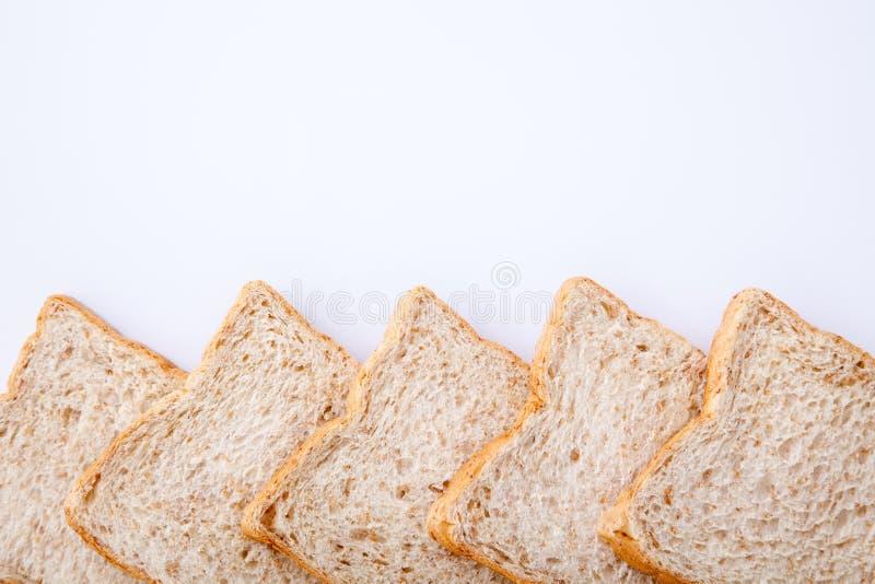 Frontera del pan del trigo integral de la rebanada imagen de archivo