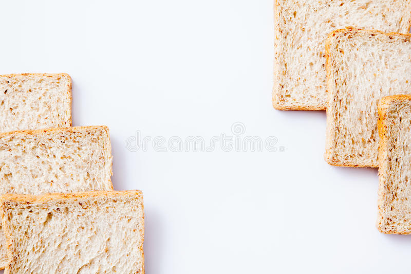 Frontera del pan del trigo integral de la rebanada fotografía de archivo