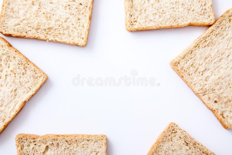 Frontera del pan del trigo integral de la rebanada fotografía de archivo libre de regalías