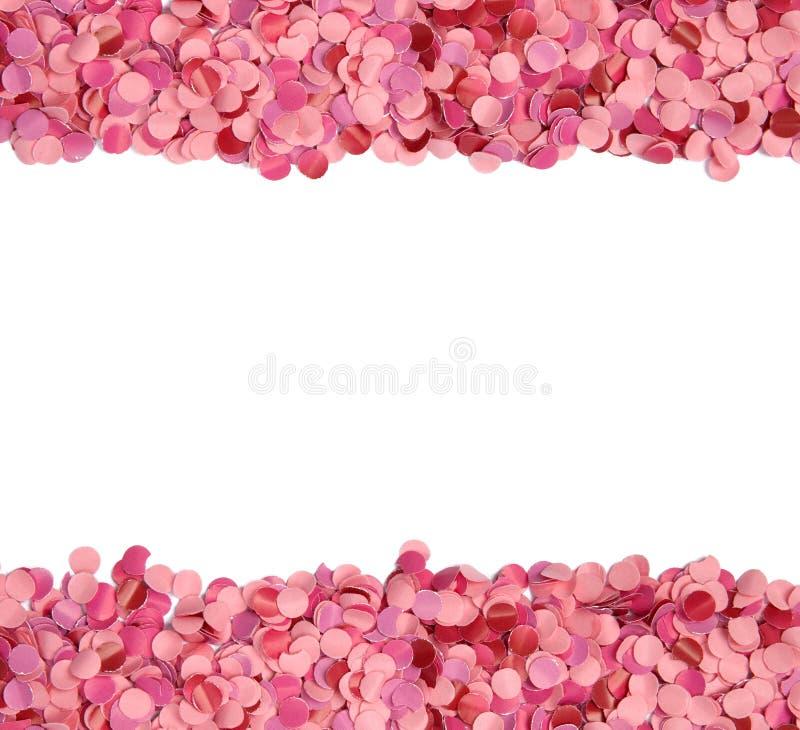 Frontera rosada del confeti imagen de archivo