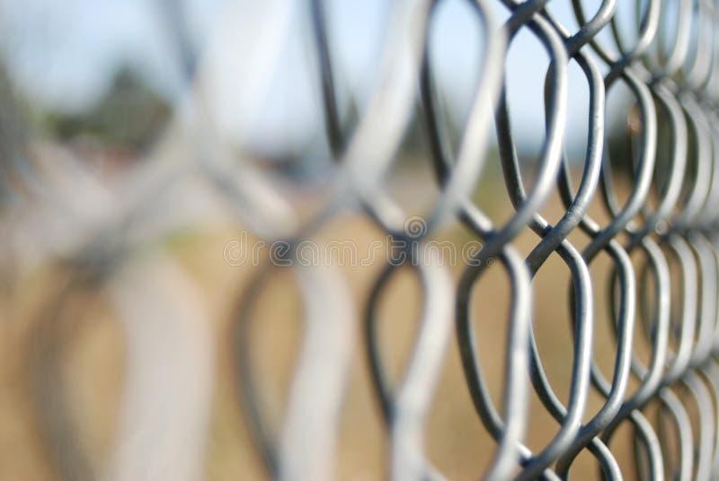 Frontière de sécurité de fil de maille photographie stock