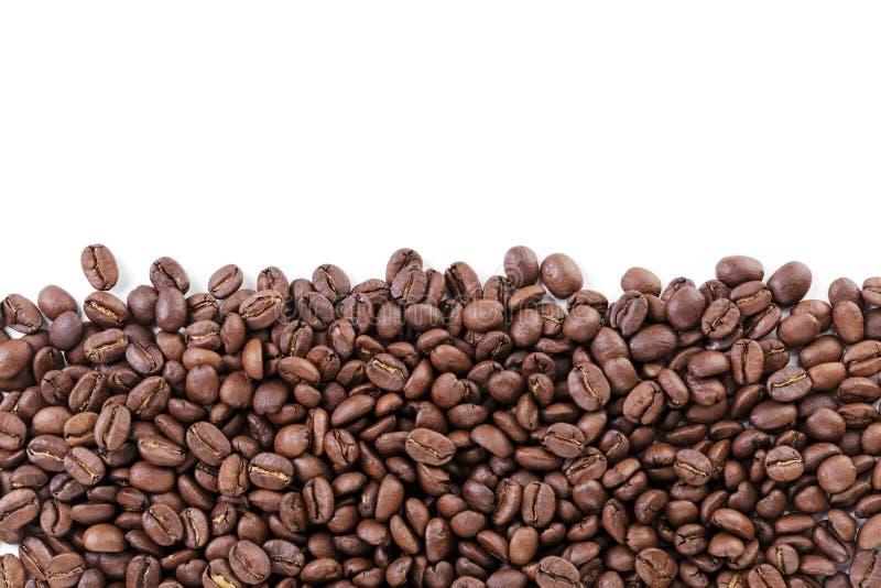 Frontière fraîchement rôtie de grains de café photos stock