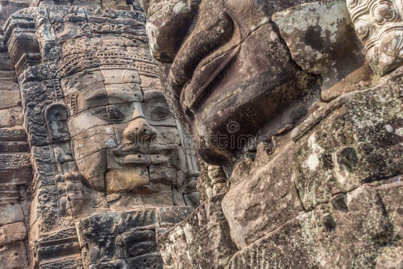 Fronti del tempio di Angkor Thom, in Siem Reap Cambogia fotografie stock libere da diritti