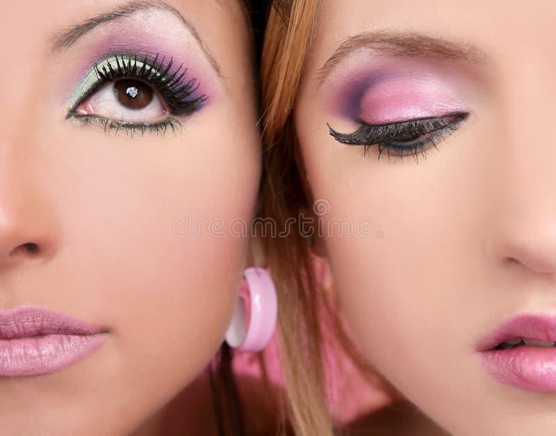 Fronti di macro due del closeupl di trucco nel colore rosa fotografia stock libera da diritti