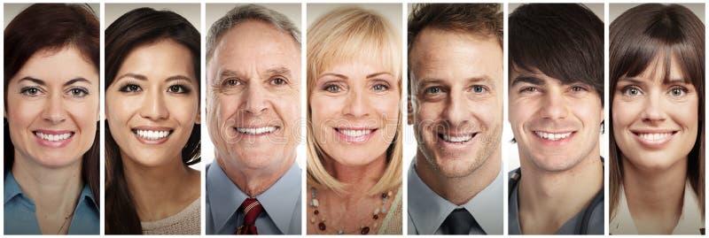 Fronti sorridenti felici della gente fotografia stock
