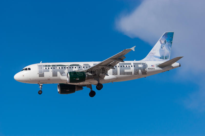 Frontier Airlines Airbus A319. LAS VEGAS, USA - WINTER 2007 Frontier Airlines Airbus A319-111, N940FR, cn 2465 approaching McCarran. Snow hare tail logo royalty free stock photography