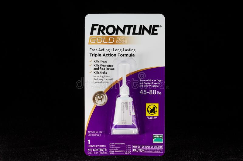 Frontline Gold Container and Trademark Logo. ST. PAUL, MN/USA - MARCH 16, 2019: Frontline Gold flea and tick preventative medicine for dogs and trademark logo royalty free stock photo